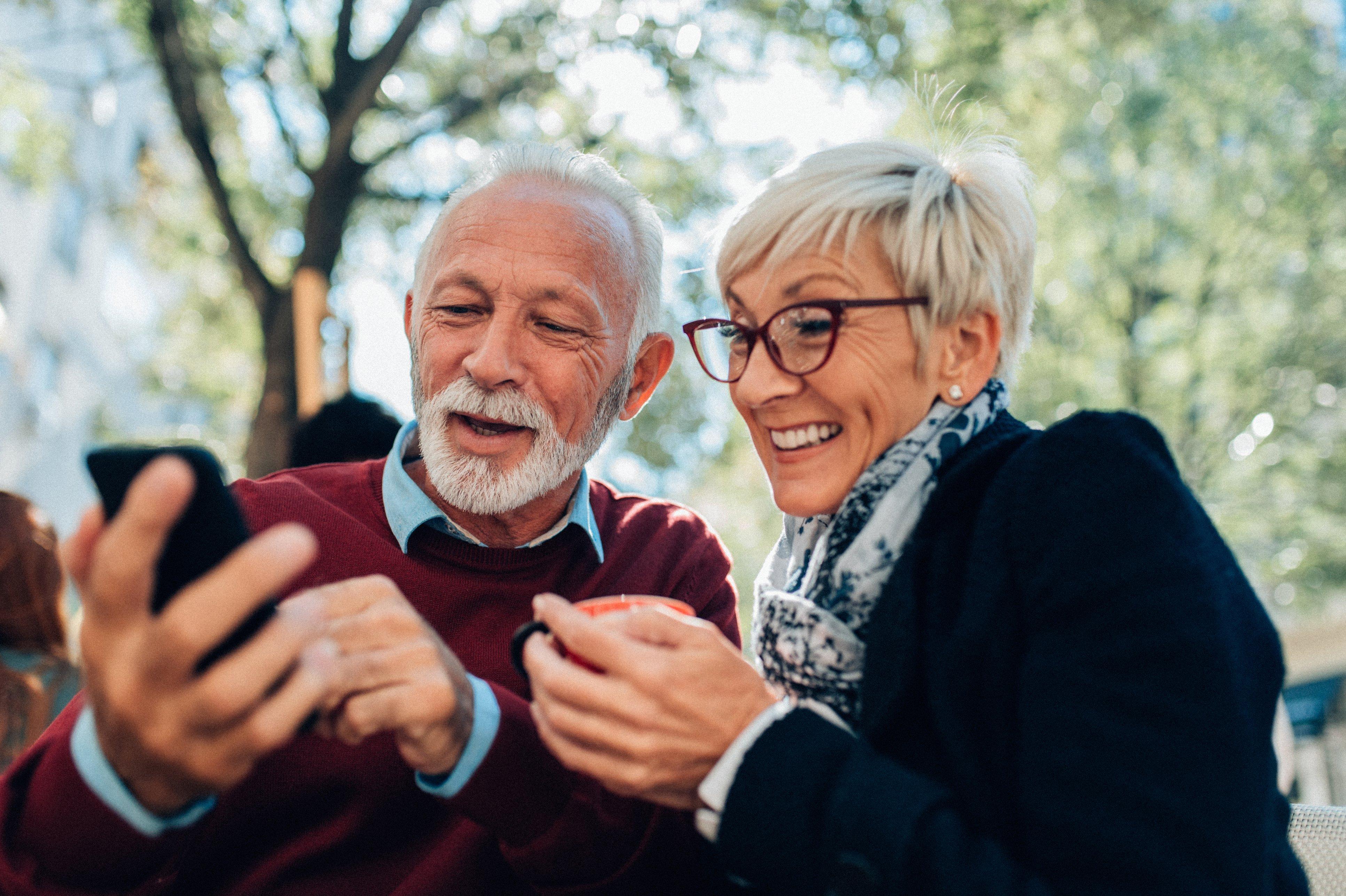 Mature Couple Using Smartphone